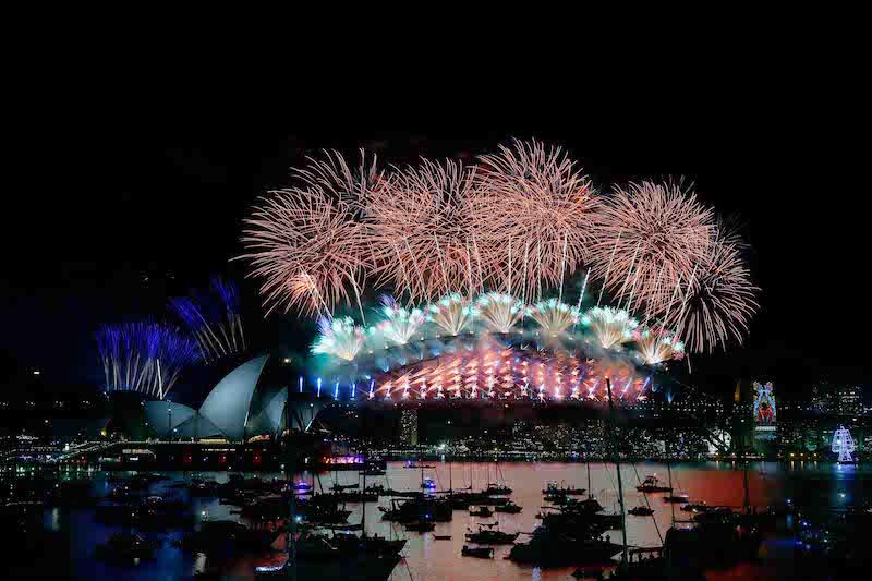 SYDNEY, AUSTRALIA - JANUARY 01: The midnight fireworks on display on New Year's Eve on January 1, 2016 in Sydney, Australia. (Photo by Zak KaczmarekCity of Sydney/Getty Images)